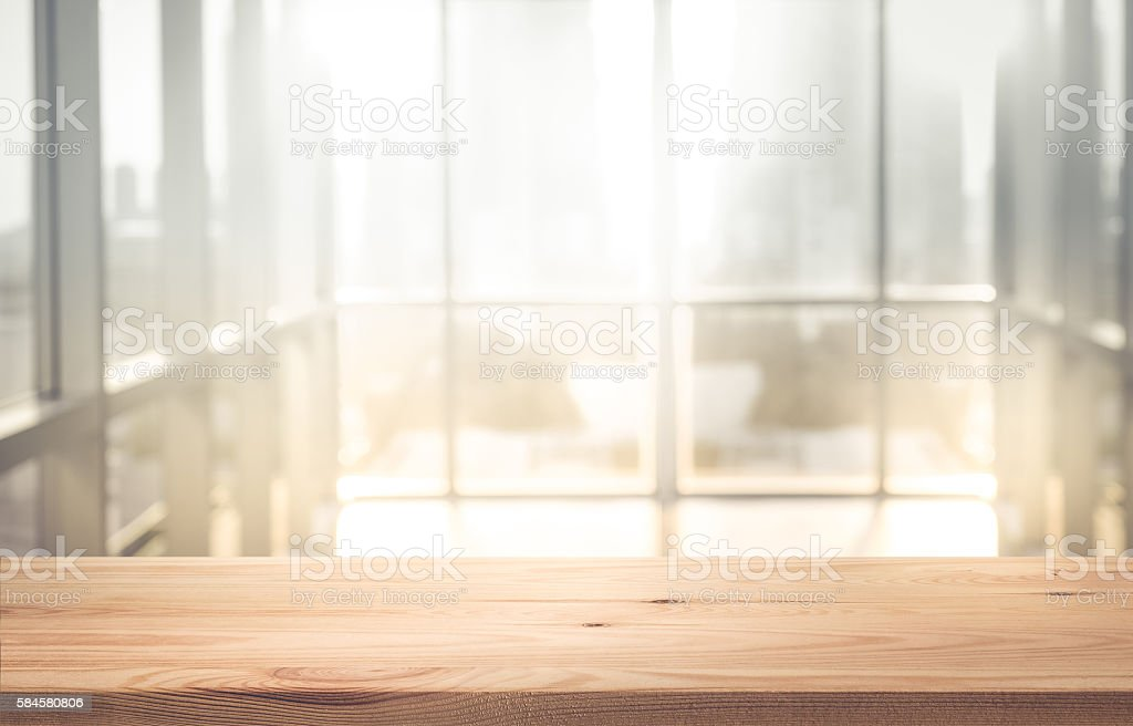 Empty wood table top with blur sunlight in window building stock photo