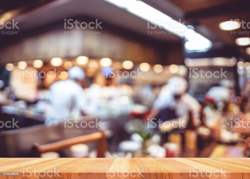 Empty wood table with blur restaurant background,Mock up Templat stock photo