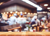 Empty wood table with blur restaurant background,Mock up Templat