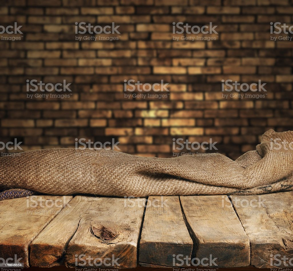 Empty wood table with brick backdrop stock photo