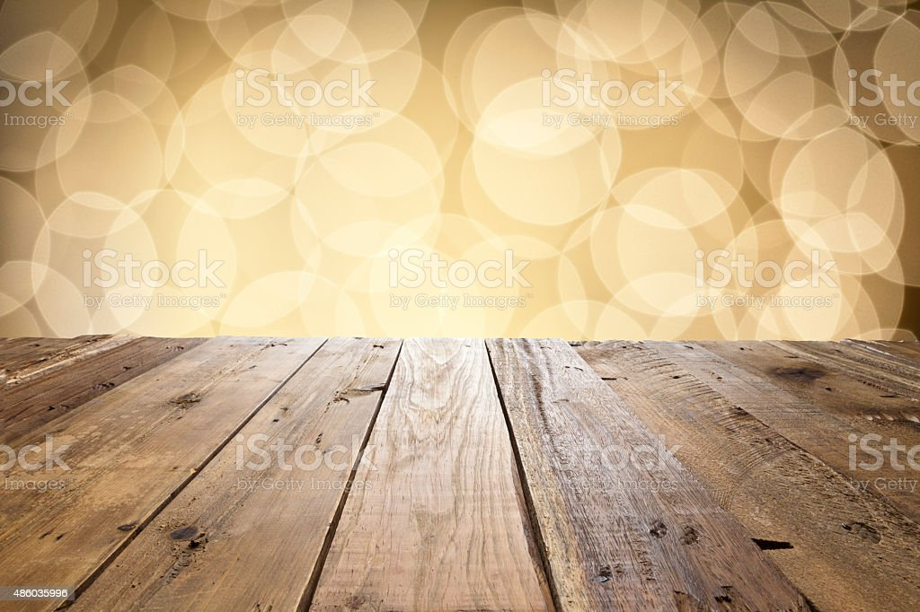Empty wood table with defocused lights at background stock photo