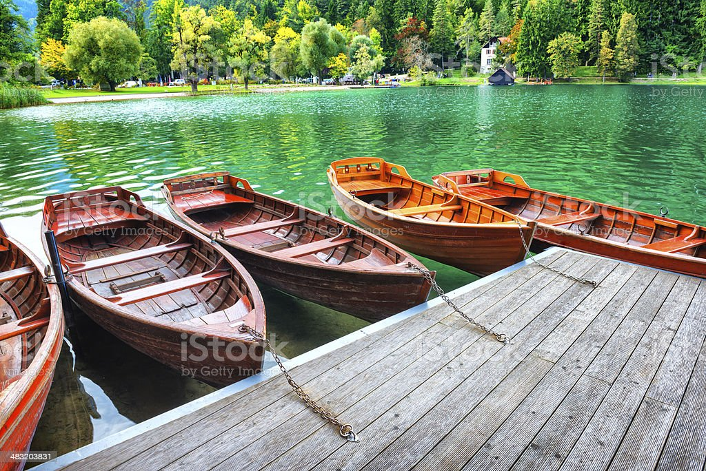 Empty Wooden Boats Resting Tied to Dock at the Lake royalty-free stock photo