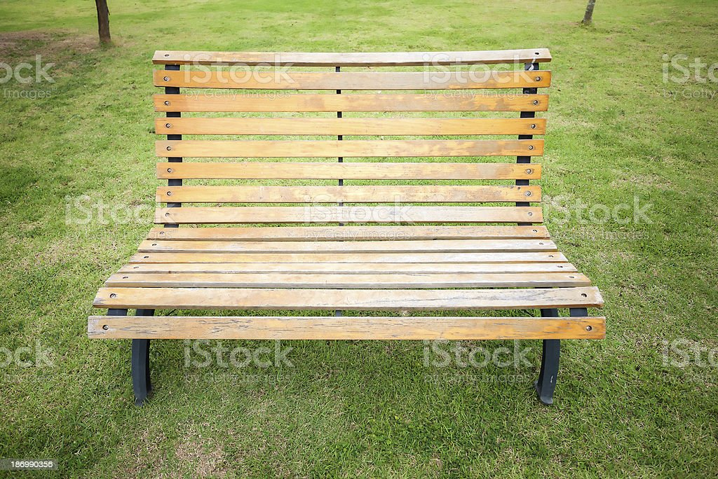 Empty wooden chair in a park royalty-free stock photo