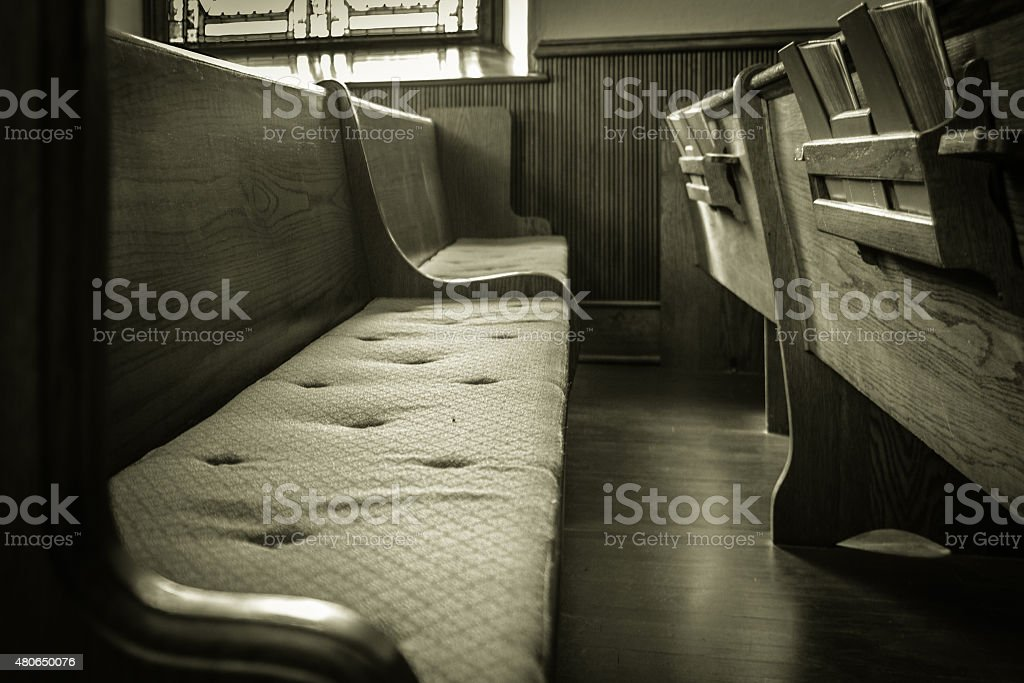 Empty  Wooden Church Pew With Bibles stock photo