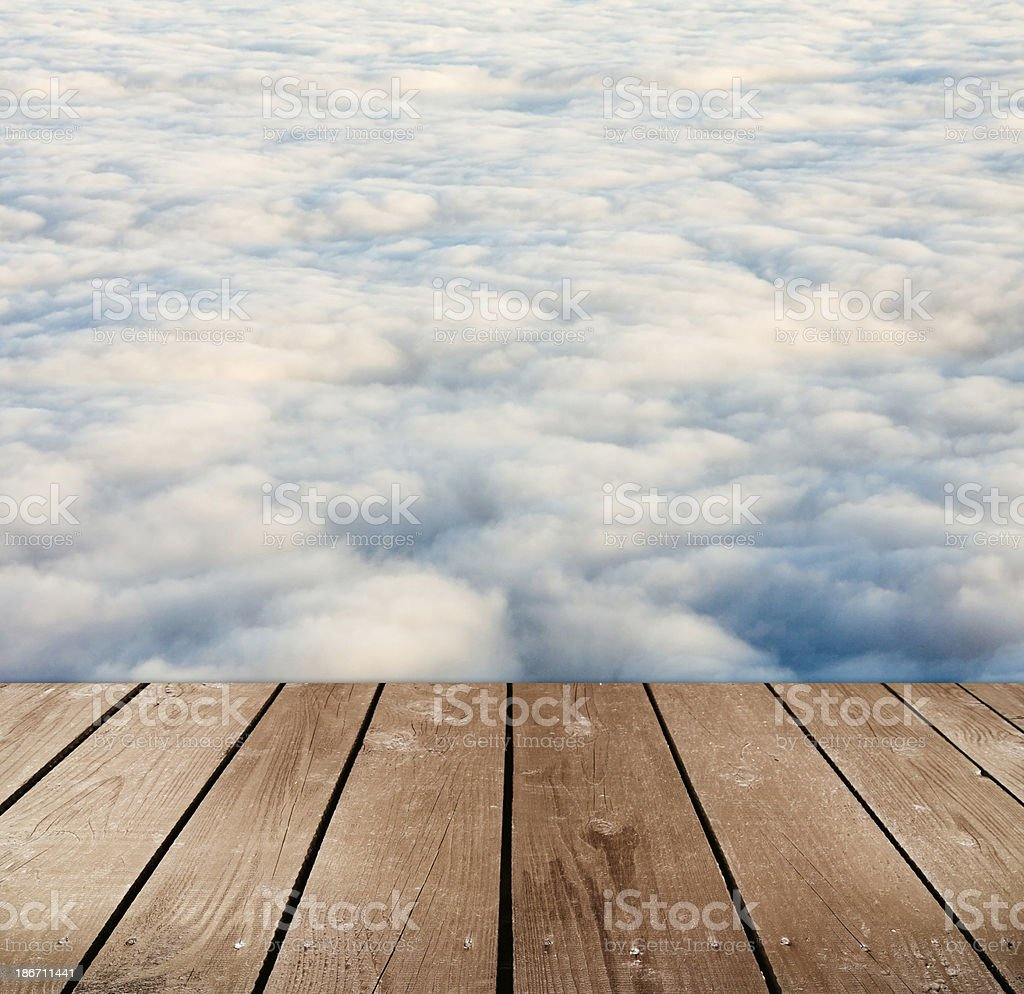 empty wooden deck table with clouds. royalty-free stock photo