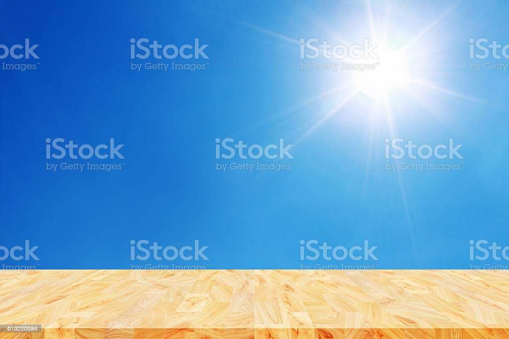 empty wooden floor for display with sun shines on blue stock photo