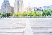 empty wooden floor with city skyline background