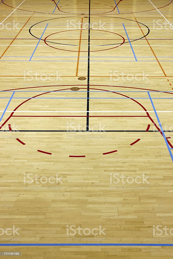 Empty wooden floor with colored lines in a gym royalty-free stock photo
