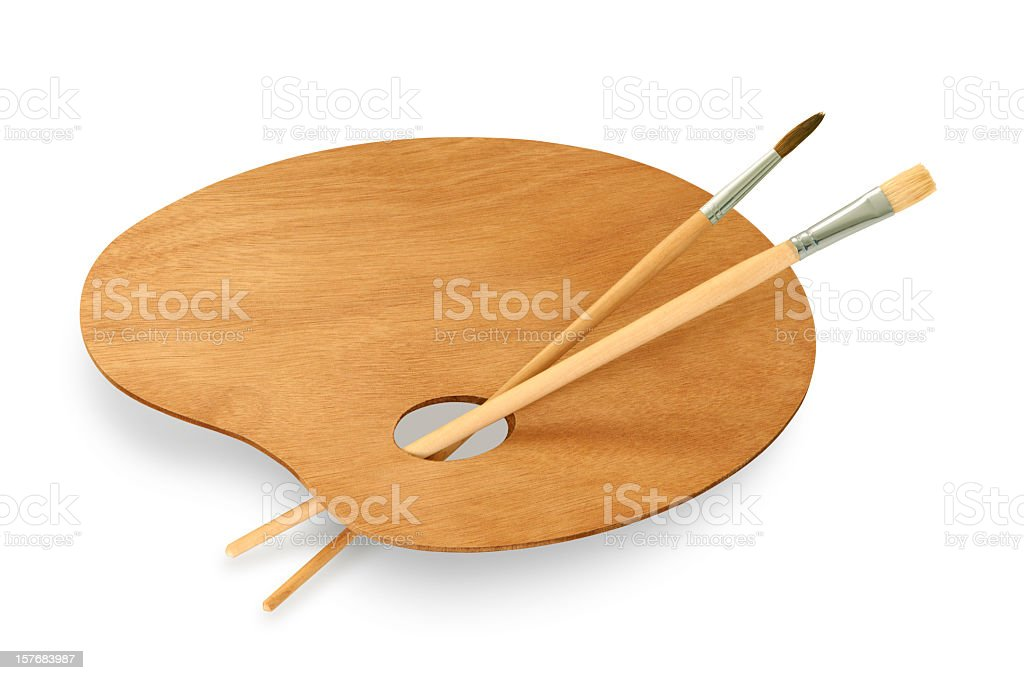Empty wooden painters palette with brushes on white stock photo