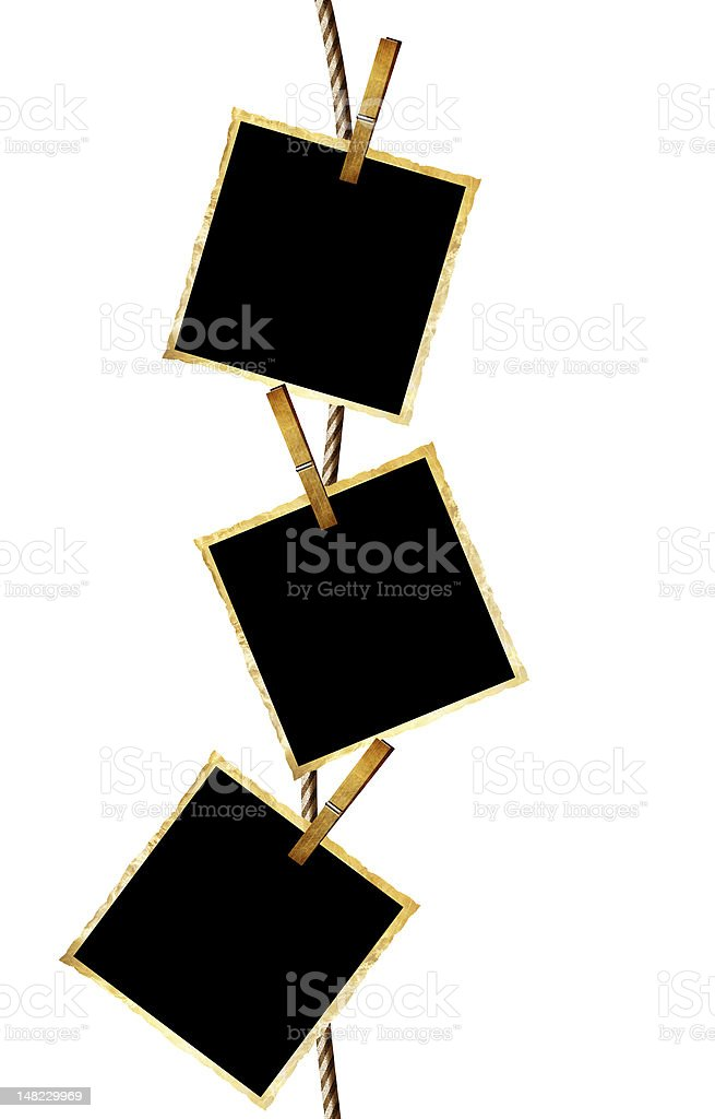 Empty wooden picture frames hanging from clothesline royalty-free stock photo