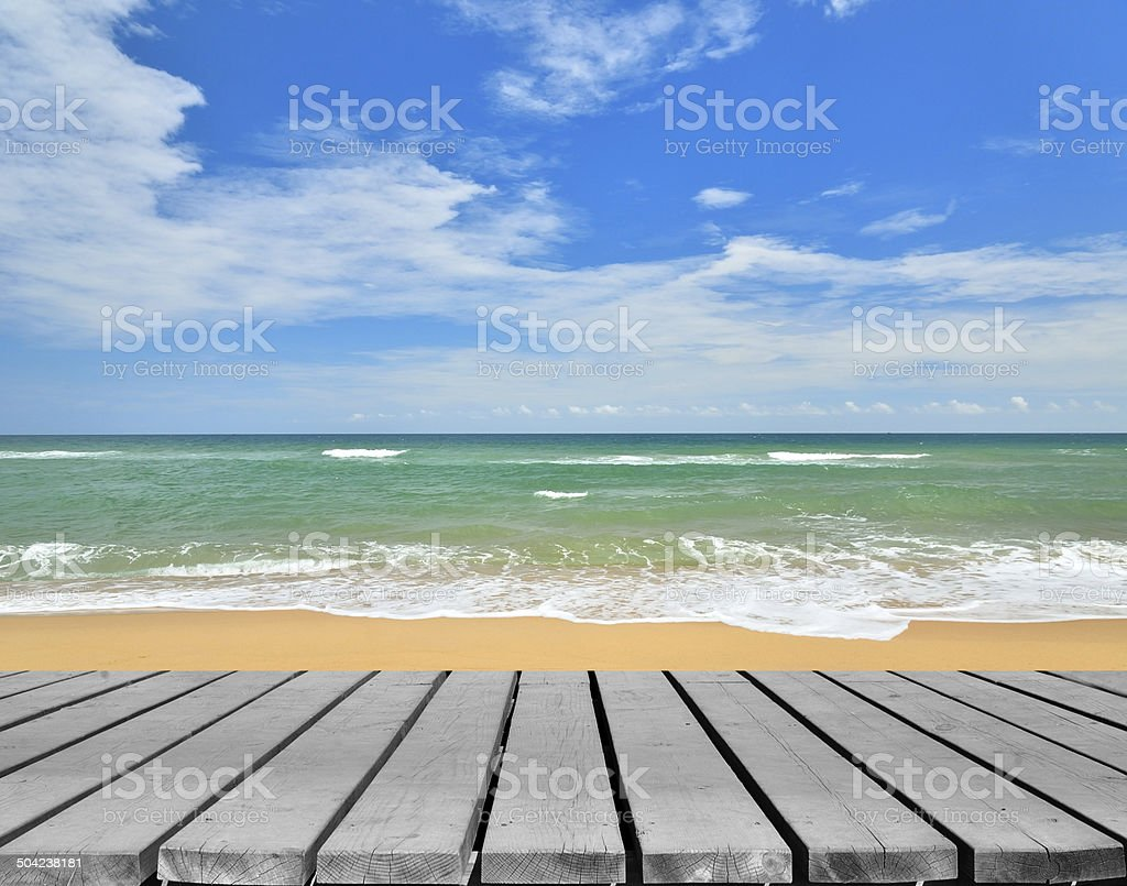 Empty wooden pier beside tropical sea stock photo