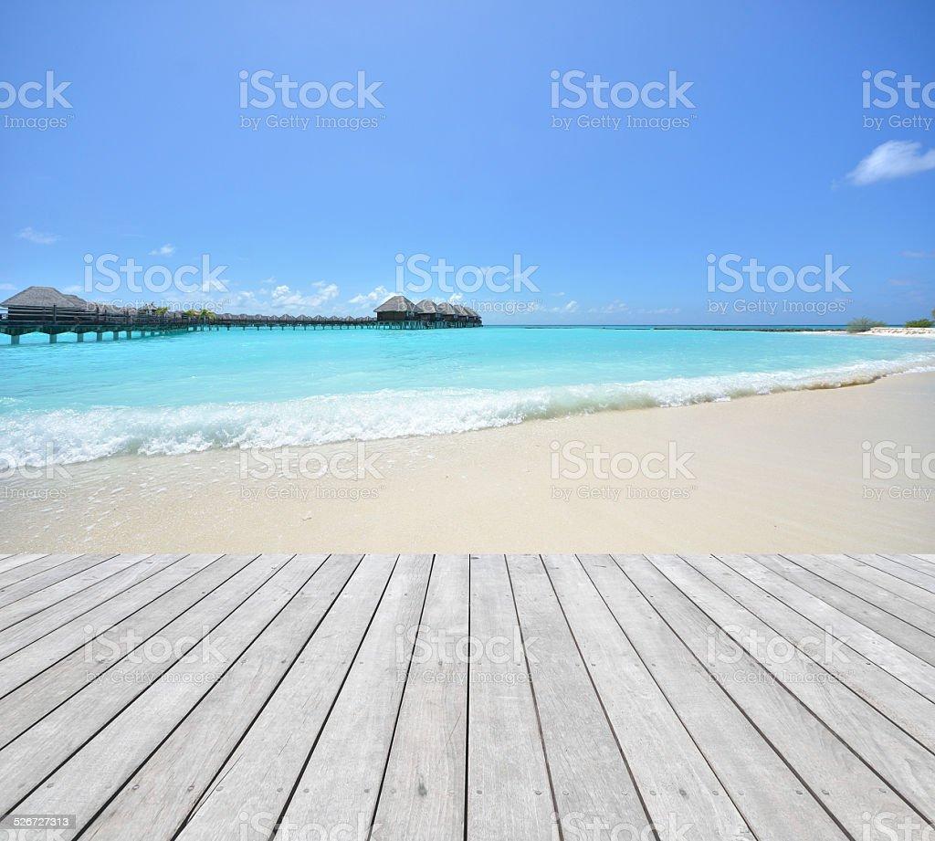 Empty wooden pier beside tropical sea stock photo