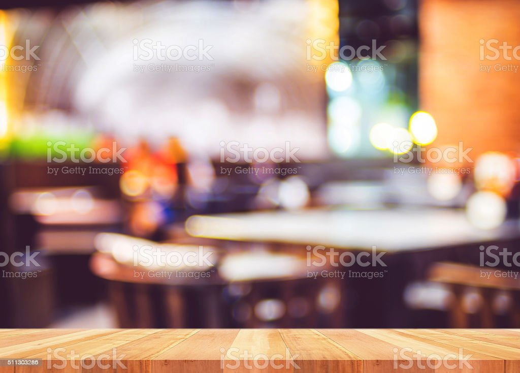 Empty wooden plank  table with blur restaurant background stock photo