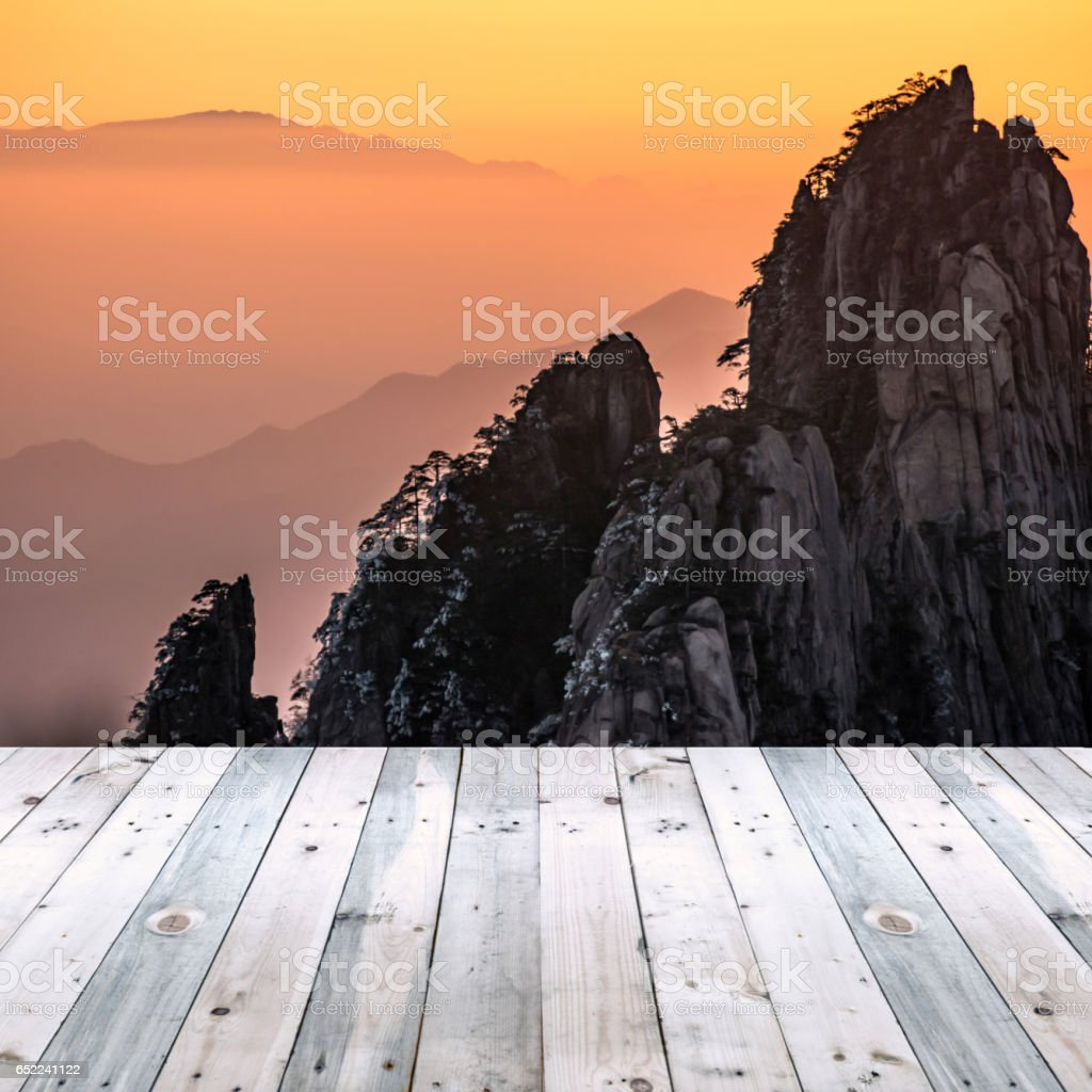 empty wooden plank with Huangsan mountain background stock photo