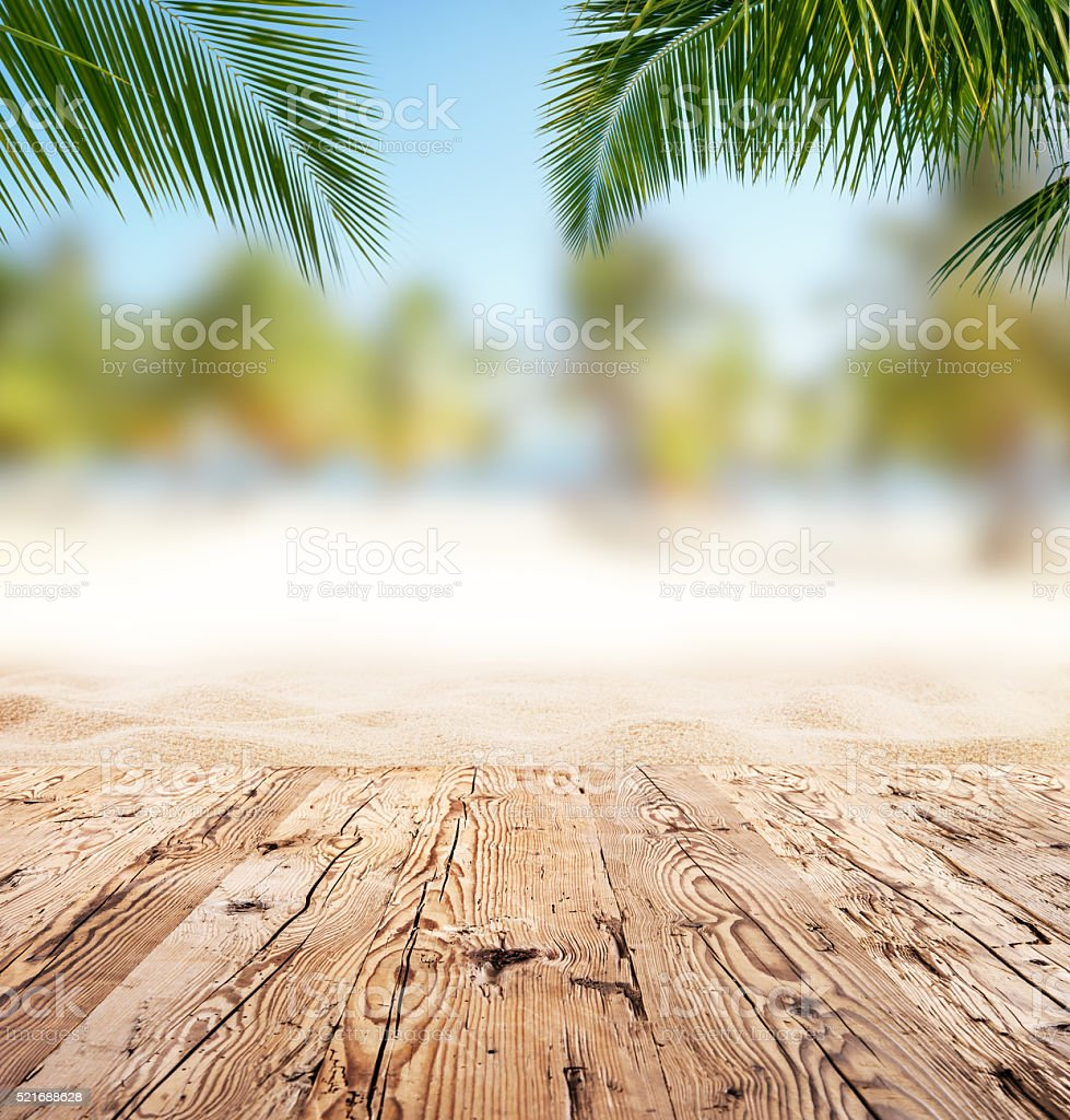 Empty wooden planks with blur beach on background stock photo