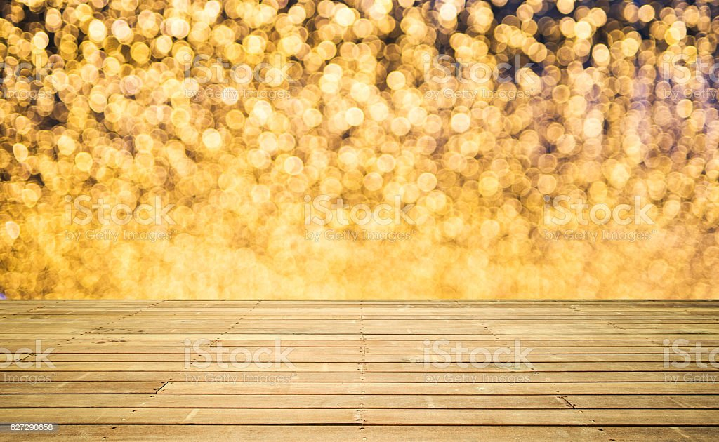 Empty wooden platform and defocused lights background stock photo