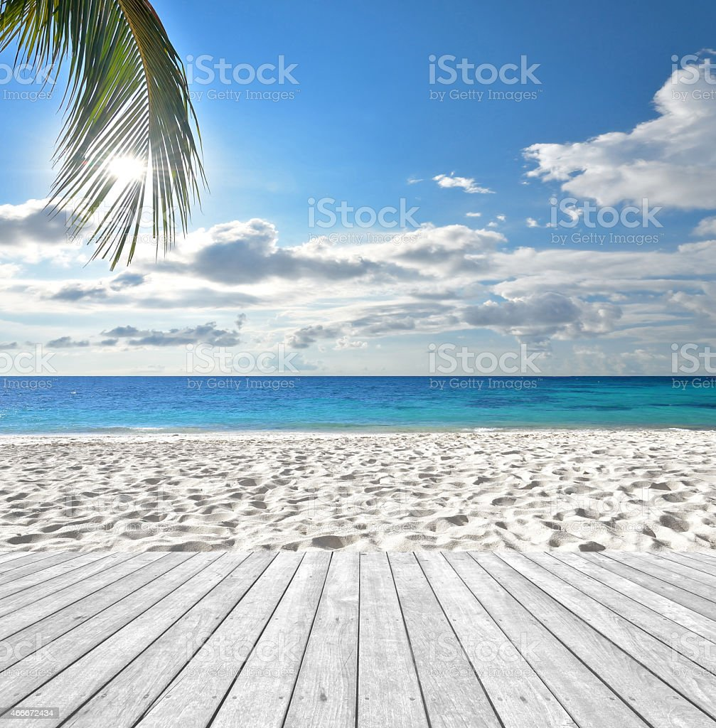 Empty wooden platform beside tropical beach stock photo