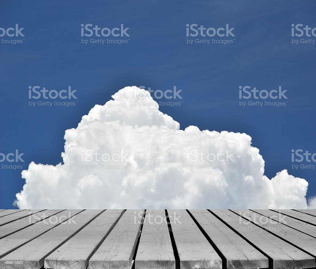 Empty wooden platform with summer cloudy sky background stock photo