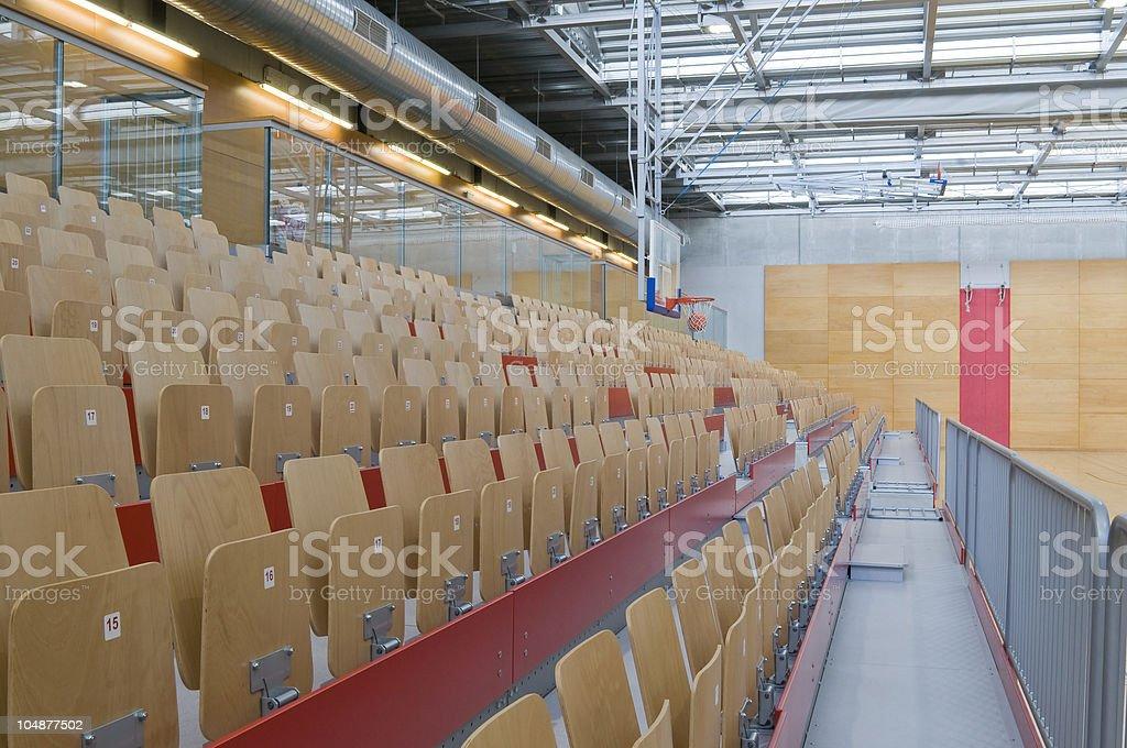 Empty wooden stadium seats on an empty hall. royalty-free stock photo