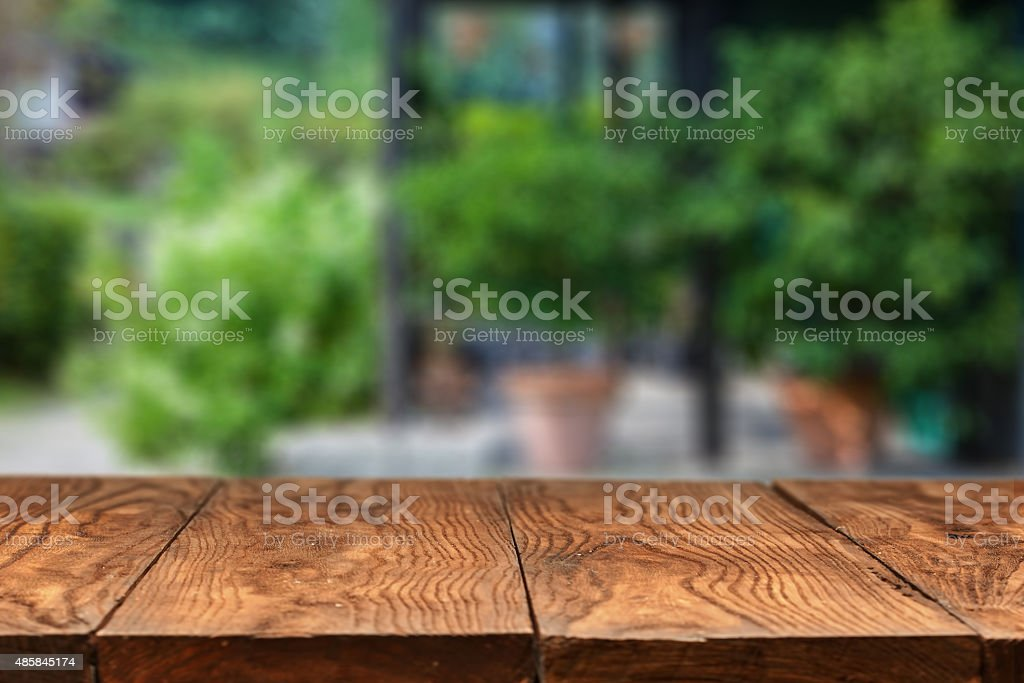 Empty wooden table against summer backyard on background stock photo