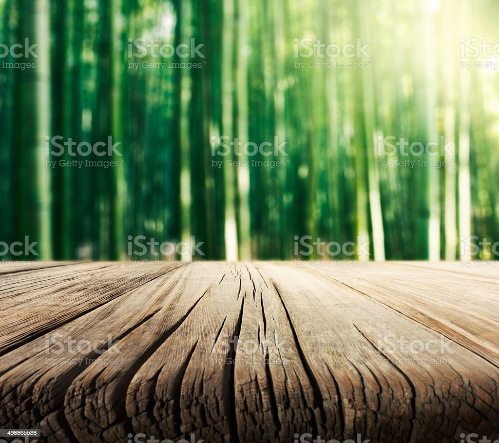 Empty Wooden Table and Bamboo Background stock photo