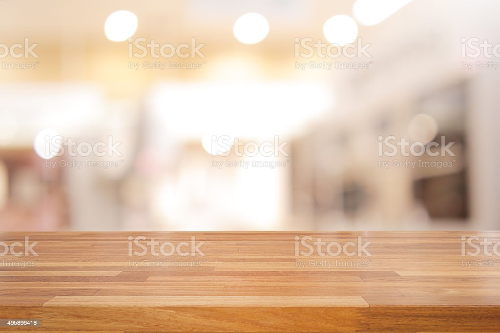 Empty wooden table and blurred cafe background stock photo