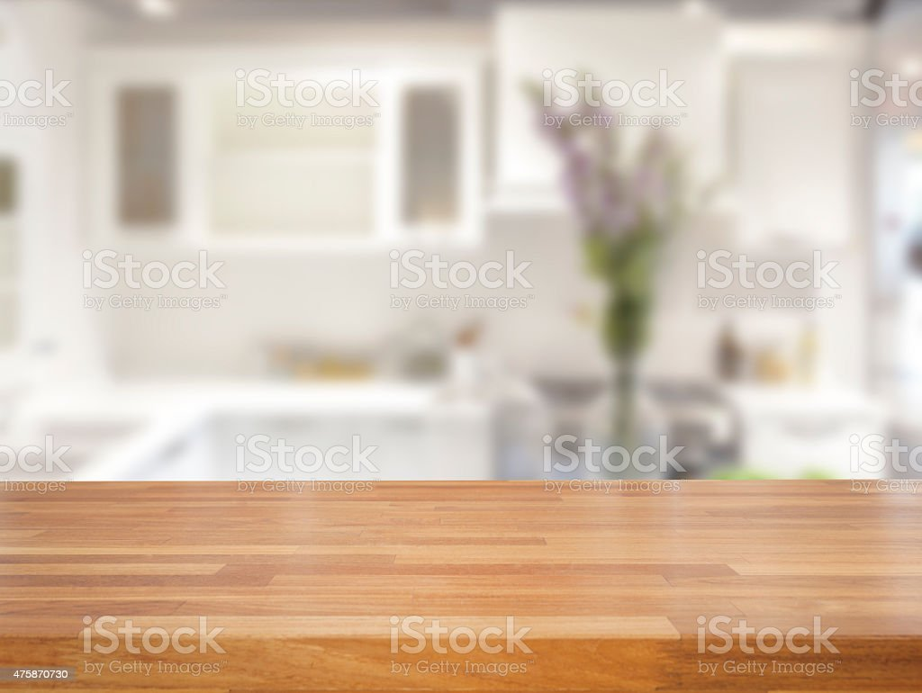 Empty wooden table and blurred kitchen background stock photo