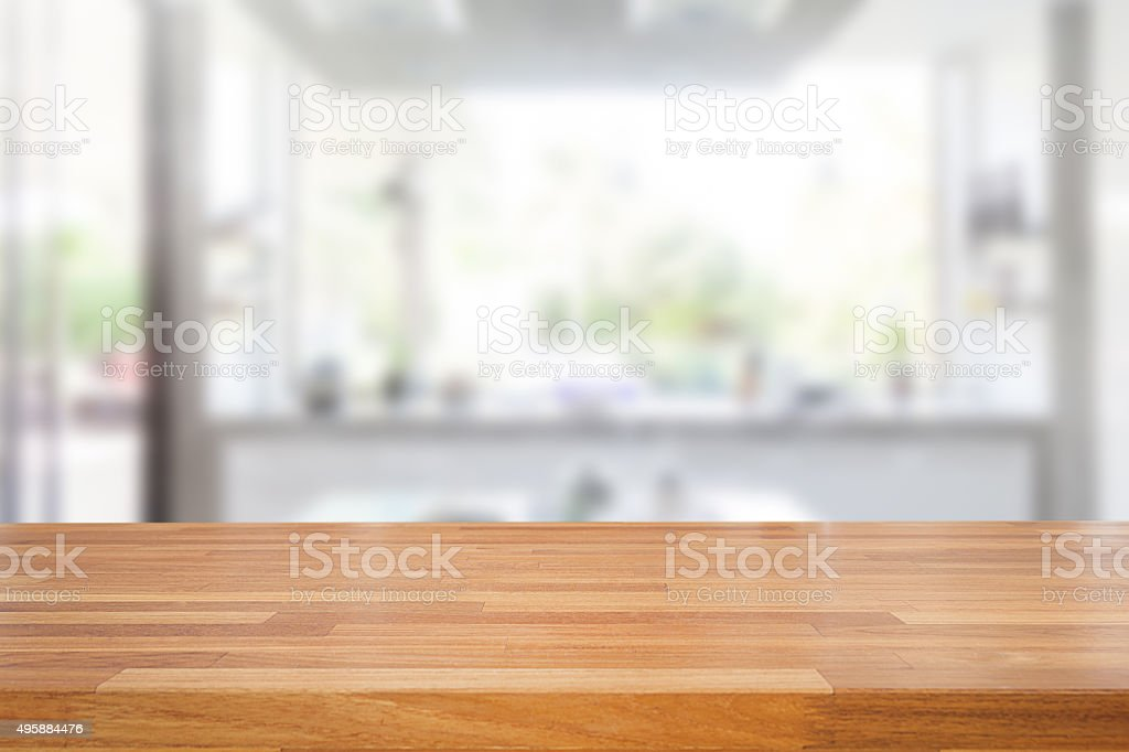 Kitchen Table Top Background empty wooden table and blurred kitchen background stock photo