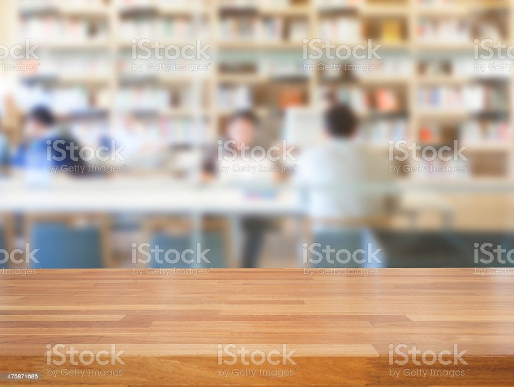 Empty wooden table and modern library background stock photo
