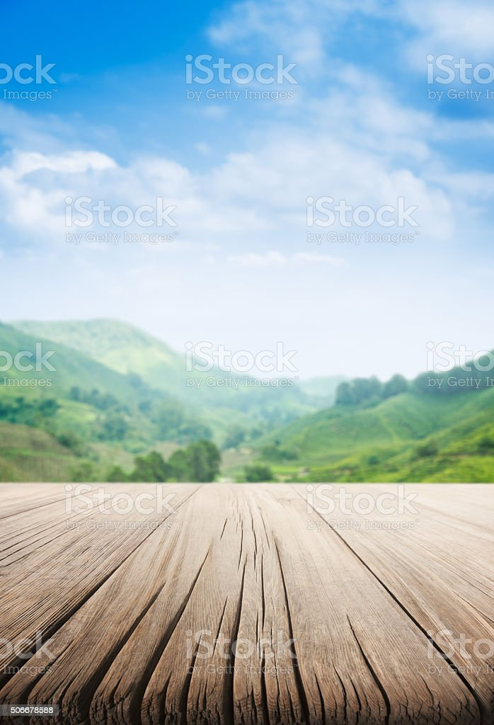 Empty Wooden Table and Tea Plantation stock photo