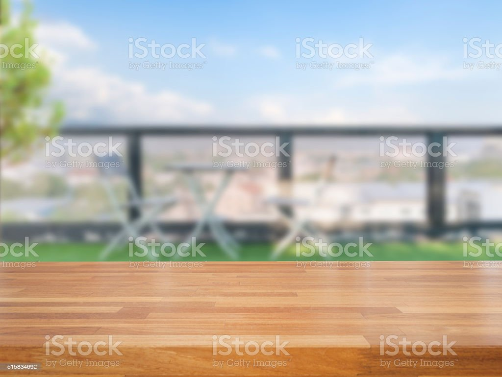 Empty wooden table  on terrace  background stock photo