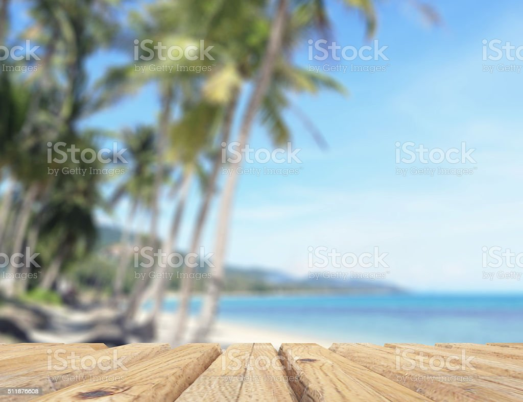 Empty wooden table on the beach. stock photo
