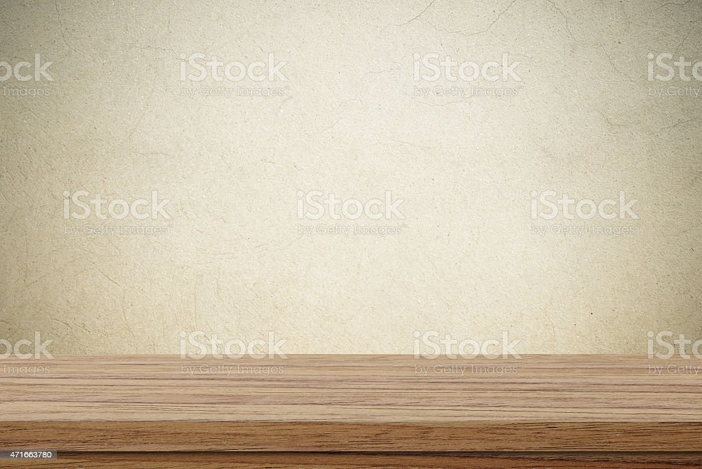 Empty wooden table over cement wall background stock photo