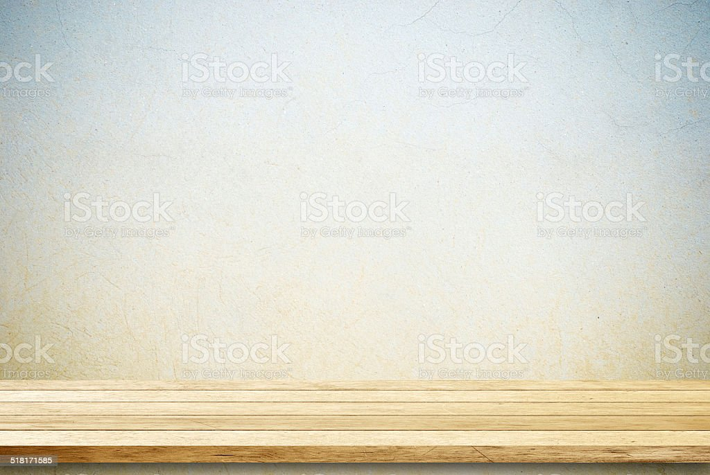 Empty wooden table over cement wall. stock photo