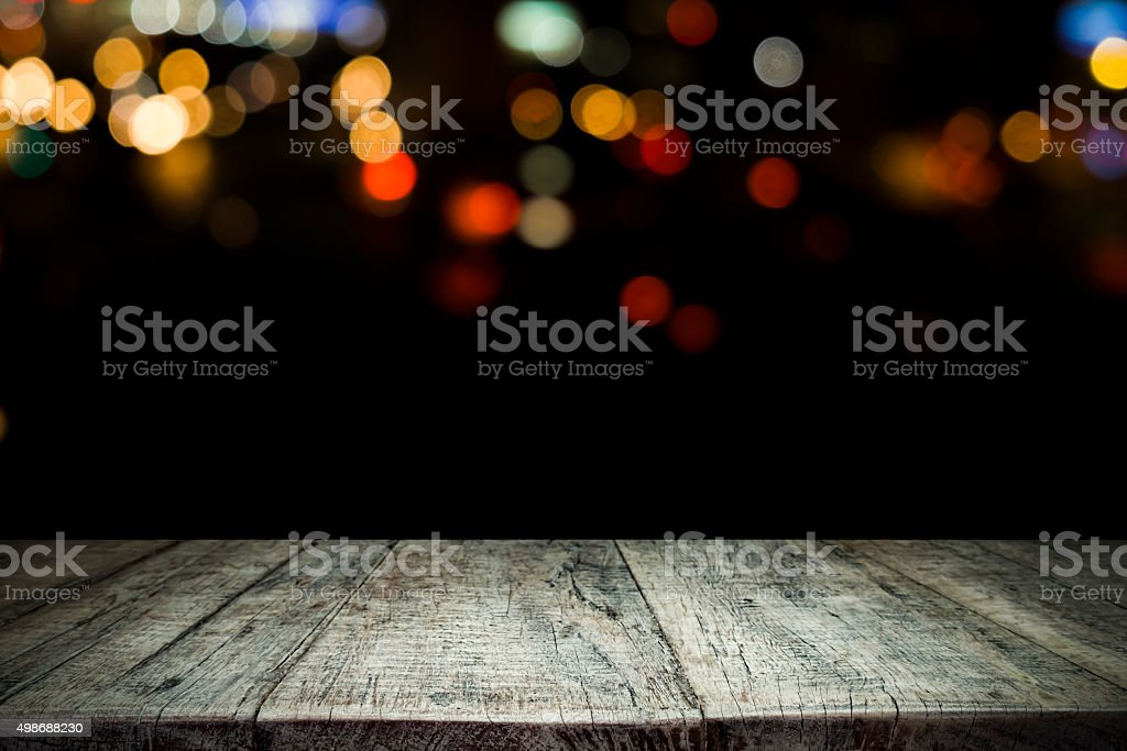 Empty wooden table platform and bokeh at night vector art illustration