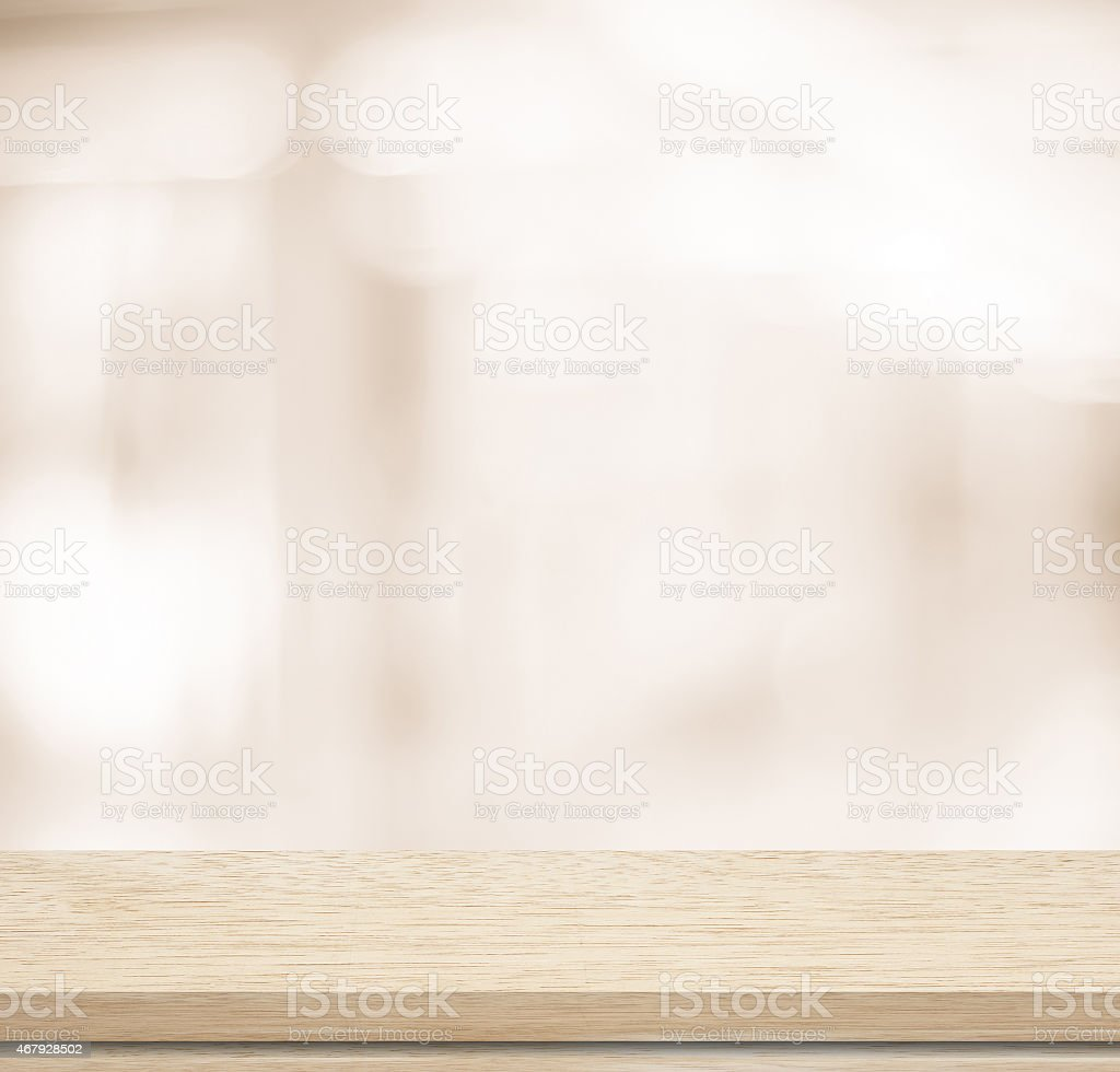 Empty wooden table with blurred background stock photo