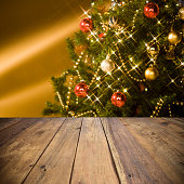 Empty wooden table with defocused christmas tree background