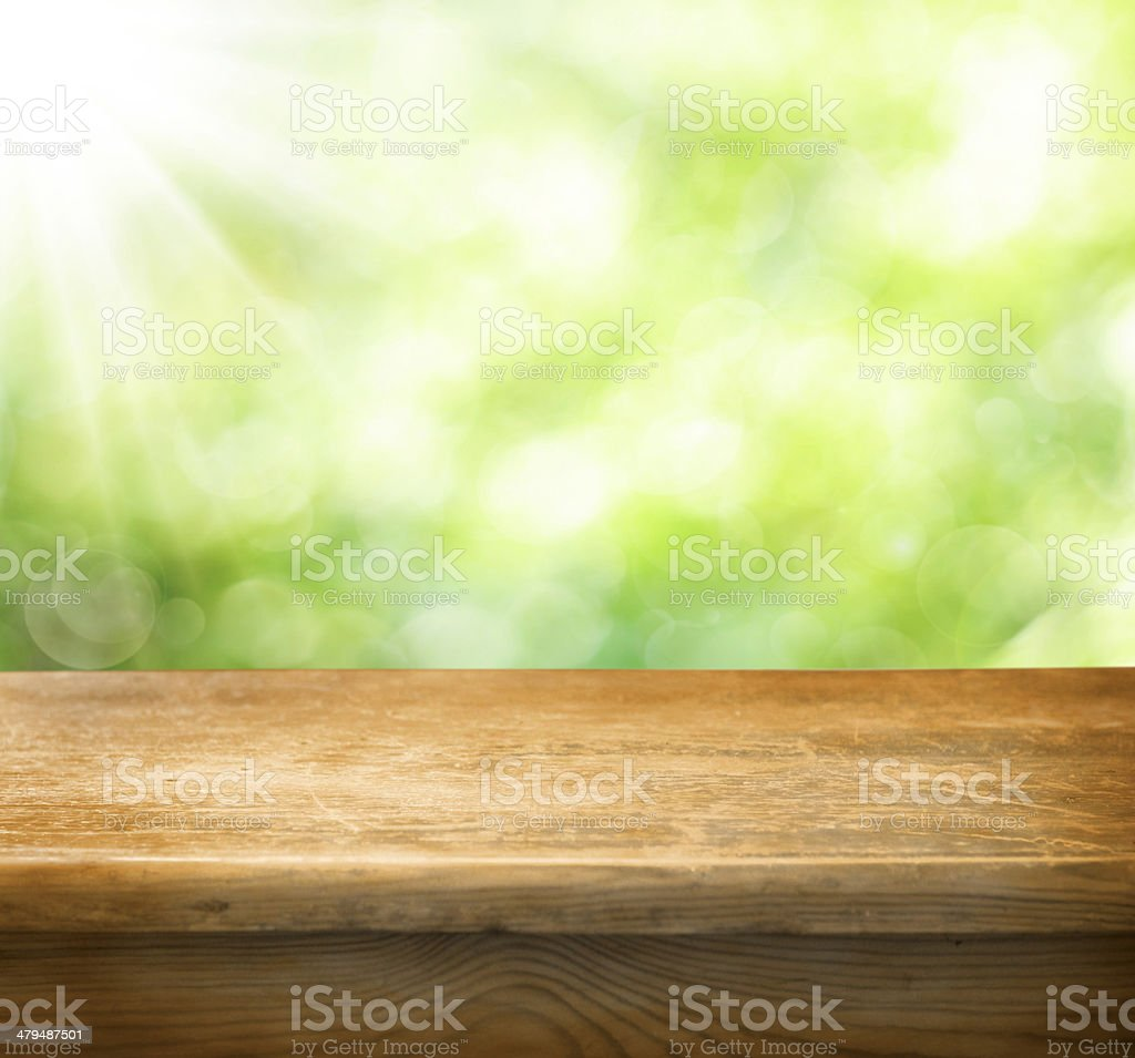 Empty wooden table with green background stock photo