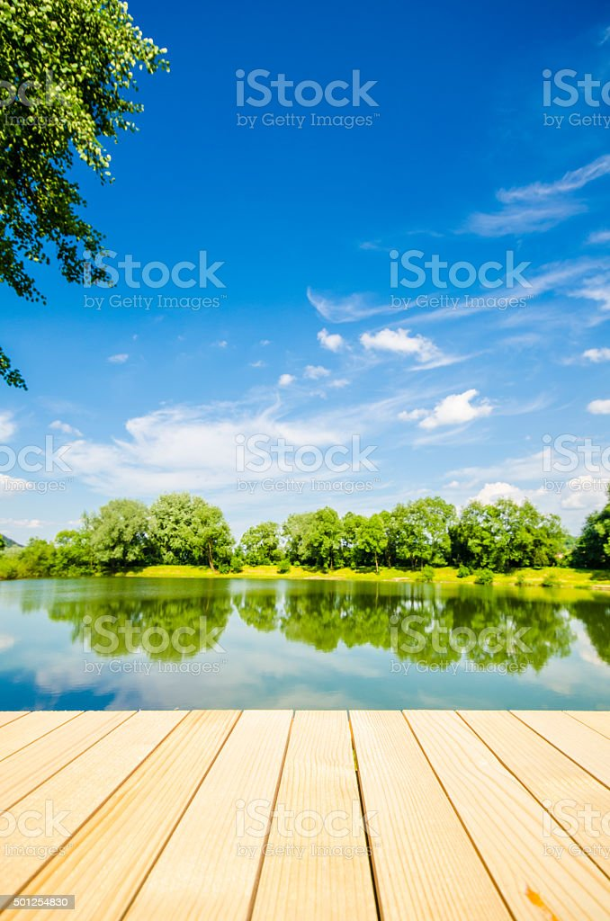 Empty wooden table with landscape background stock photo