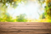Empty wooden table with nature background - Fall