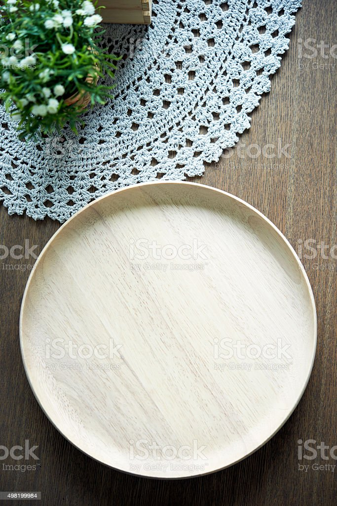 Empty wooden tray on table stock photo