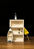 Empty wooden white shelf decorated with boat, lighthouse and lifebuoy