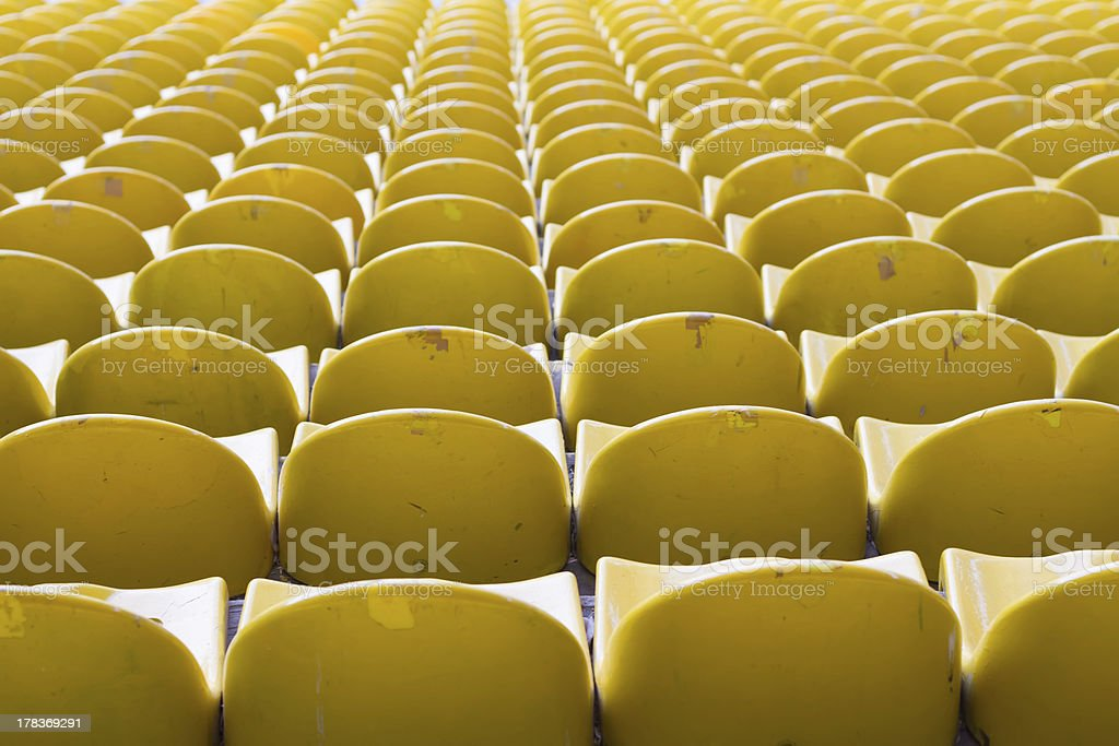Empty yellow stadium seats royalty-free stock photo