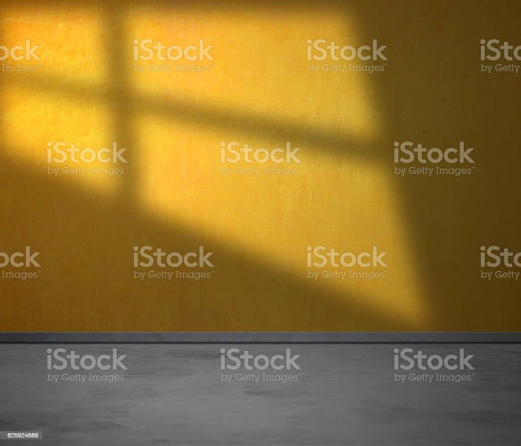 Empty yellow wall with sunlight stock photo