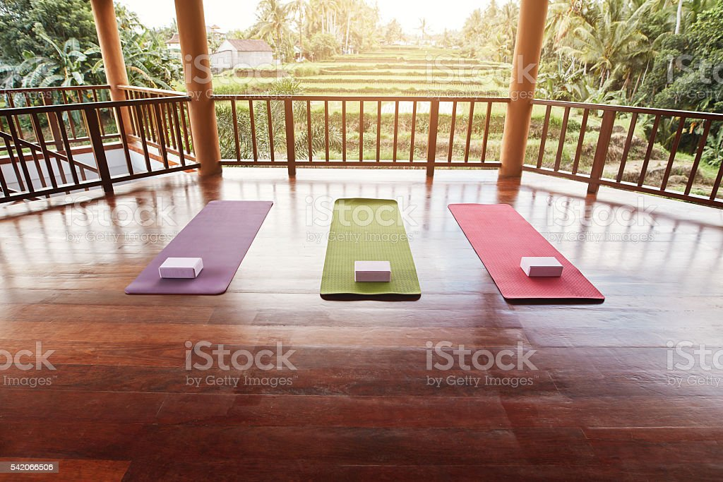 Empty yoga studio with colorful mat stock photo