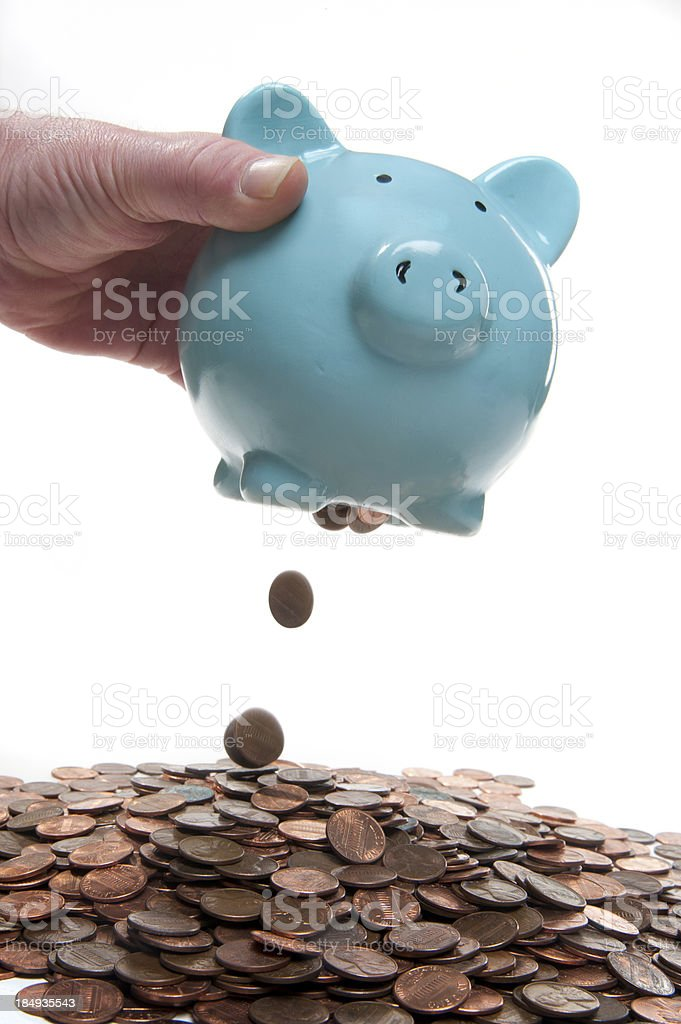 emptying a piggy bank royalty-free stock photo