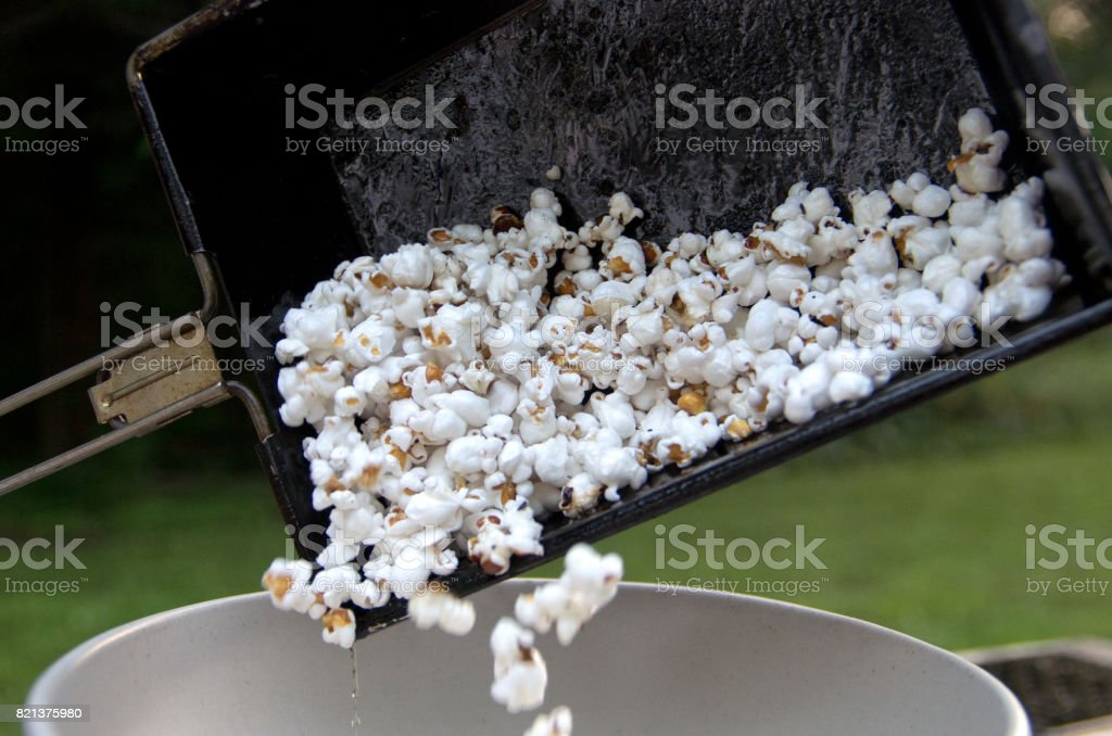Emptying Campfire Popcorn Popper stock photo