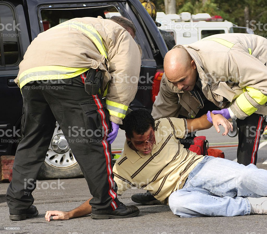 EMTs Helping An Accident Victim stock photo