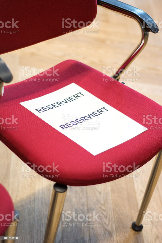 Emty chair with label 'reservation' stock photo