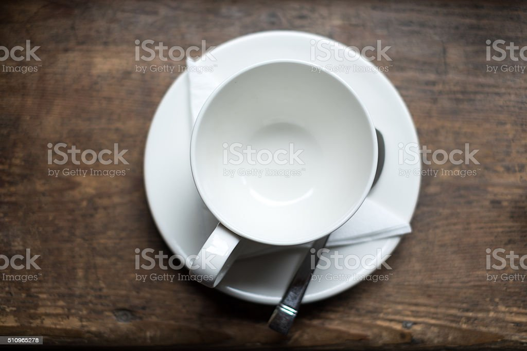 Emty tea cup on wood table stock photo